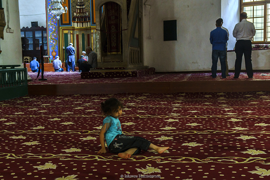 In mosque a child playing during the praying