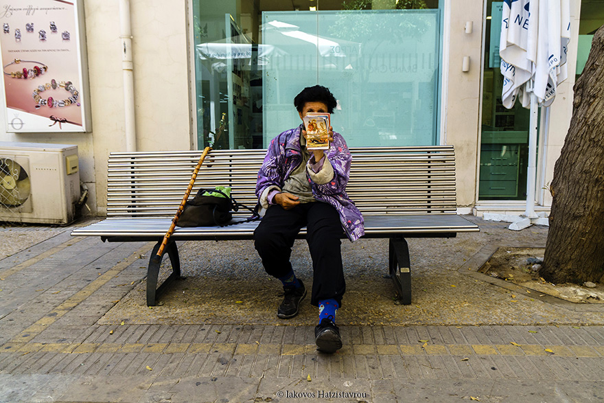 A picture taken on Ledra street shows an old woman selling icons to passers-by.