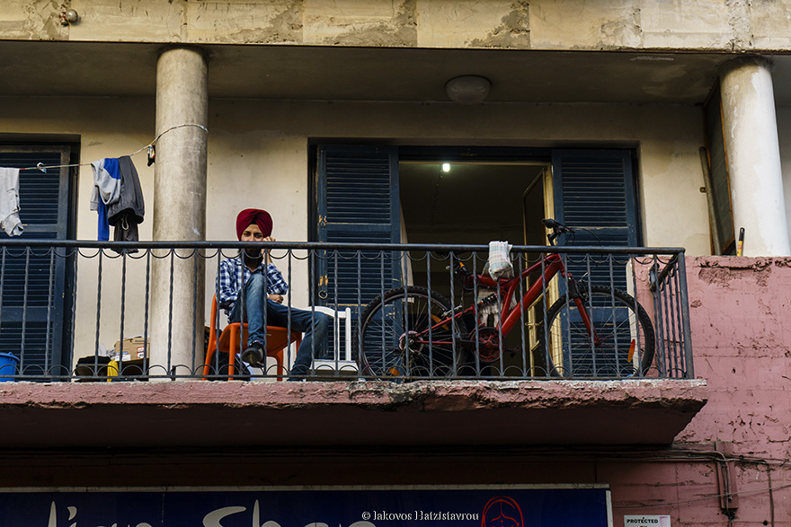 A picture taken in NICOSIA showing an man sitting in his balcony.