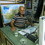 A picture taken in NICOSIA showing an old man sitting in his shop