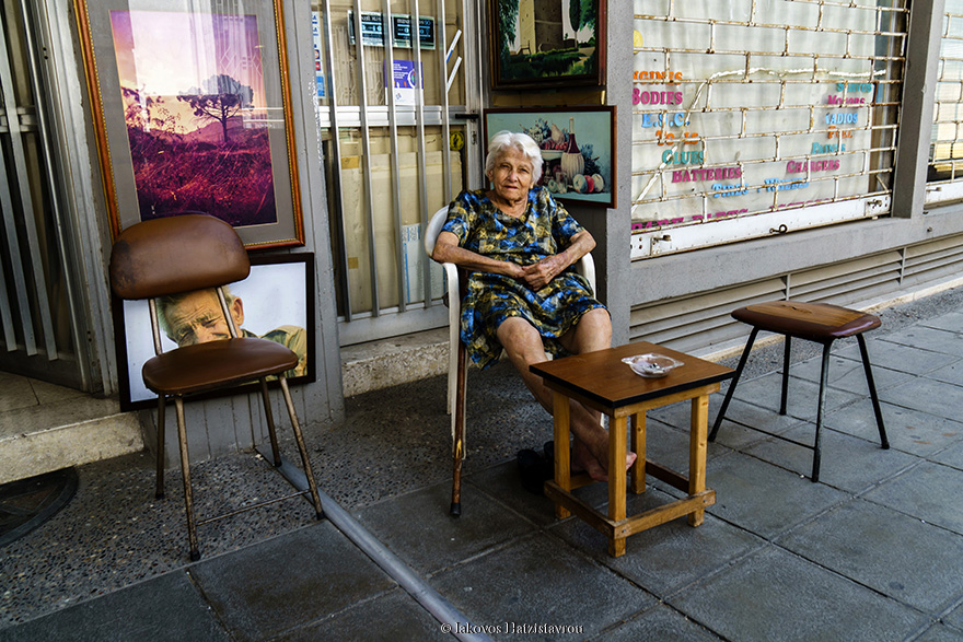 A picture taken in NICOSIA showing an old lady sitting out of a shop