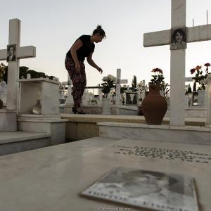 The 43nd anniversary of the Turkish invasion of Cyprus in the military cemetery in Nicosia with the graves of Greek and Cypriot soldiers killed in the 1974 from the Turkish invasion of Cyprus on July 19, 2017. A daughter take care the grave of her father